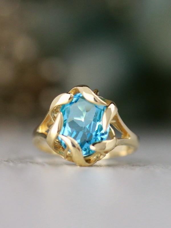 8x11MM Blue Topaz Solid 14 Karat Gold Ring with Flower Petal Encased Design
